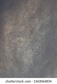 Pearlescent dark shiny silver paper texture.