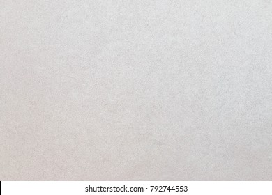 Pearlescent paper texture, off white background.