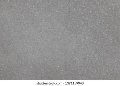 Pearlescent paper texture. Shiny silver, gray background.