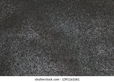 Pearlescent paper texture. Shiny silver, dark gray background.