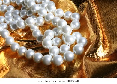 Pearls a necklace on a silk fabric