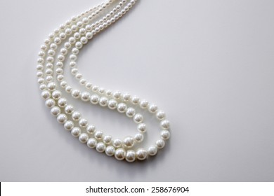 pearls necklace on the white background