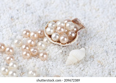 pearls in the sea shell on the sand