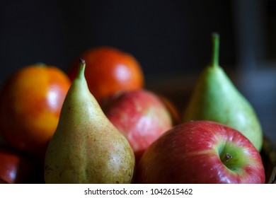 Pears, apples and other fruits in a still life