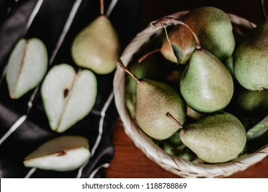 Pears in a basket on the table. Top view image