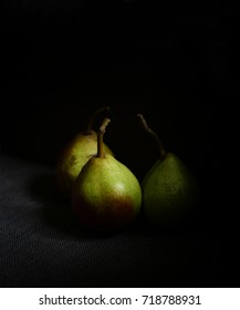 pears on a black background