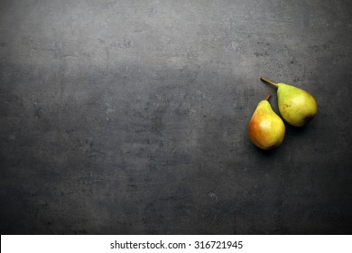 Pears on grey kitchen table with copyspace