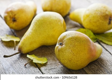 pears on wood table closeup