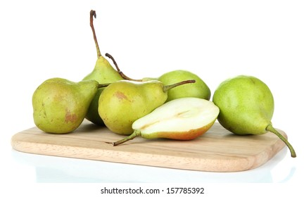 Pears on wooden cutting board, isolated on white
