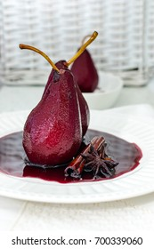 Pears poached in red wine, with star anise