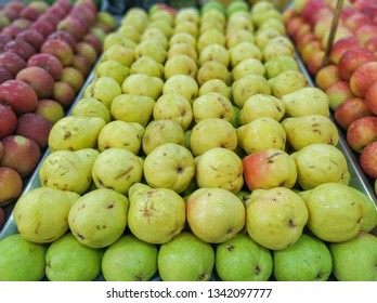 pears for sale in supermarket in hortifruti section, with blurred background