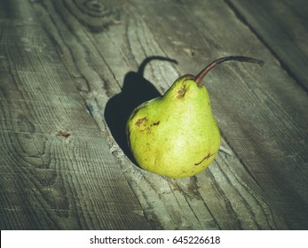 pears, wooden background, selective focus and toned image