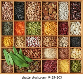 Peas, beans and lentils in wooden box