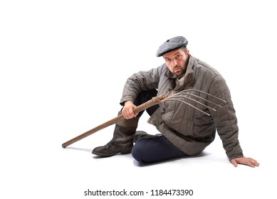 Peasant man with pitchfork on white background, serious concentrated look. Idea - hard life of peasant