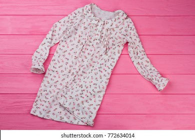 Peasant style girls  nightgown on pink wooden background. Adorable ruffles  and flowers. Kids e6473d752