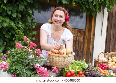 A peasant woman selling fresh vegetables at the market
