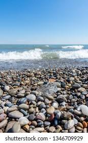 Pebble beach along the lake michigan shoreline.  Early spring/late winter.  Racine, Wisconsin.