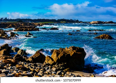 Pebble Beach, California, February 18, 2018:  Wave action on the rocks at Pebble Beach highlighting Bird Rock, Seal Rock, Cypress Pint Golf Course, Fan Shell Beach located on the 17 Mile Drive.
