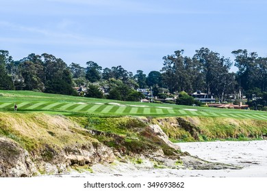 Pebble Beach, California, USA - April 29, 2015:  The Pebble Beach Golf Course, viewed looking up from the rocks below.