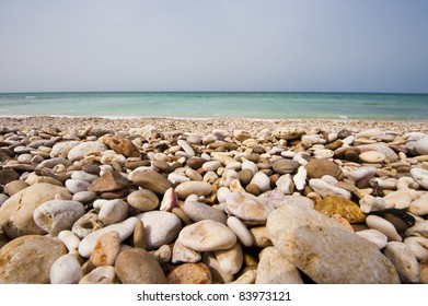 Pebble beach on the coastal road between Quriat and Sur in Oman.
