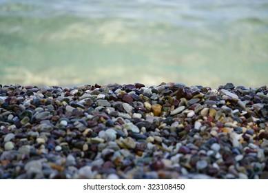 Pebble beach with sea.  Greece. Corfu. Dassia.