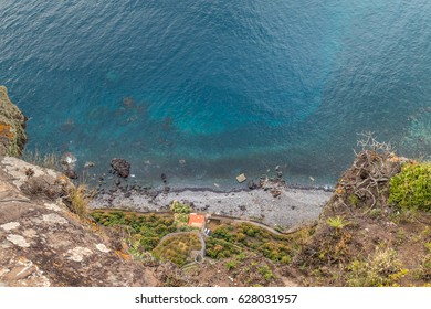 Pebble beach seen from a high point  on a heap and the clear blue ocean