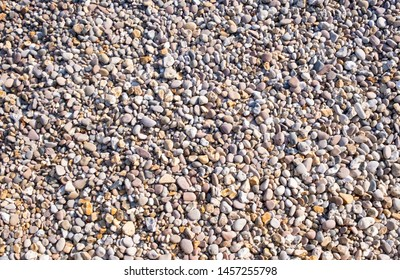 Pebble beach, softly shaped stones on shingle beach weathered by tide and water