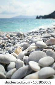 Pebble close up in Lalaria beach, in the island of Skiathos in Greece