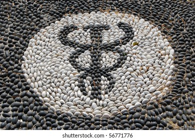 Pebble mosaic of the symbol of Hypocrates