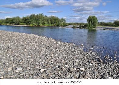 Pebble river banks. Polar Ural, Komi Republic, Russia.