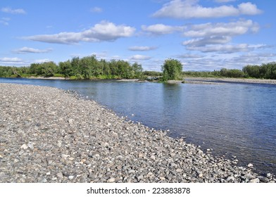 Pebble river banks. Polar Ural, Komi Republic, Russia.