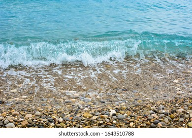 Pebble shore of French Riviera in Nice, natural background