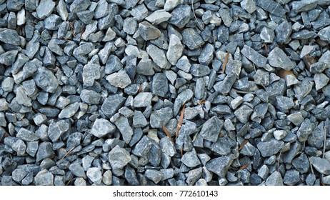Pebble stone background. Crushed stone texture.