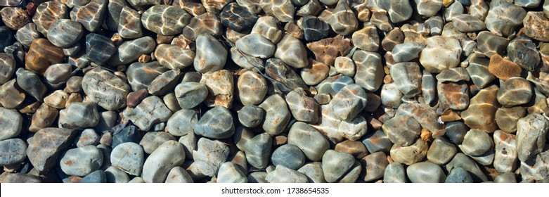 Pebble stones are lying under water