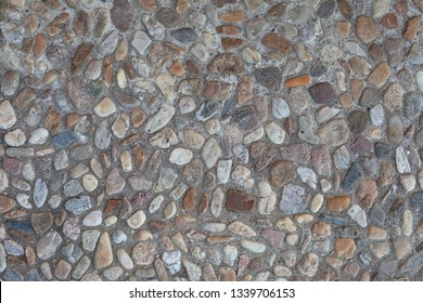 "Pebble stones texture. Wash concrate covering texture. Surface of washbeton. Stony wallpaper. Beton pavement surface. Tumbledstones pattern. In german language: ""Waschbeton"". Cobble stone concrete."
