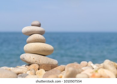 Pebble tower standing on the left on the sea beach