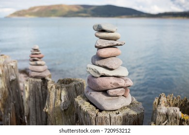 Pebble Towers Built on Wooden Posts on Porlock Beach, England
