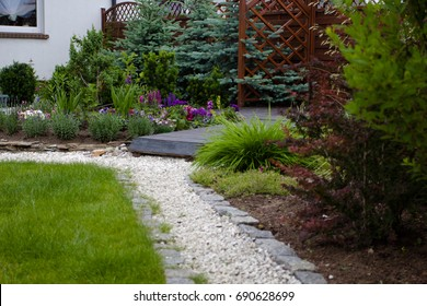a pebbled path in the garden