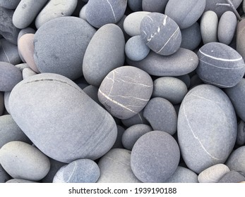 Pebbles background, abstract background with round gray stones,