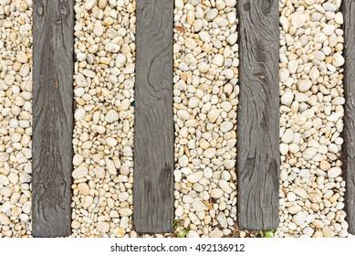 Pebbles between old wooden