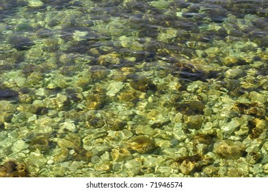 pebbles in the clear sea water