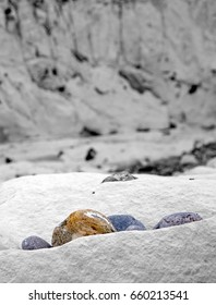 Pebbles of colors in a universe in black and white (Saint Marguerite on sea, Somme Bay, France).