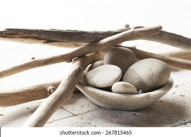 pebbles with drift wood for mineral spa treatment