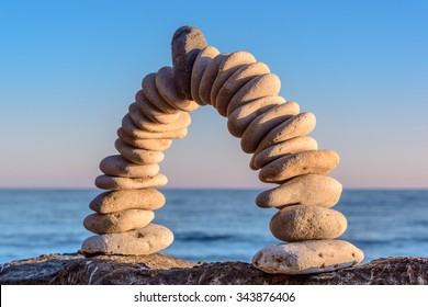 Pebbles in the form of a arch on sea background