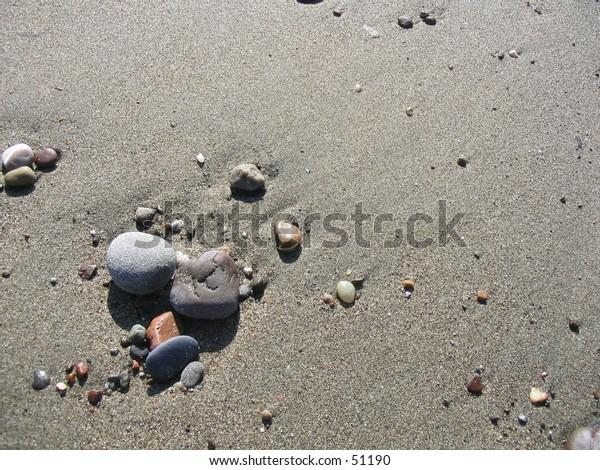 Pebbles on beach.