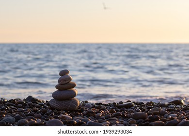 pebbles on the seashore against the background of the sea