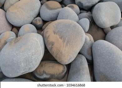 Pebbles on Westwood Ho Beach at Northam Burrows on the Atlantic Coast in North Devon, England, UK