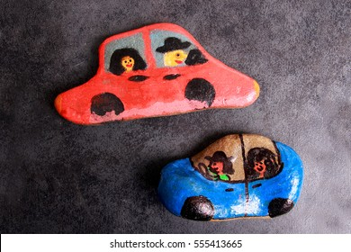 Pebbles painted cars -shaped closeup