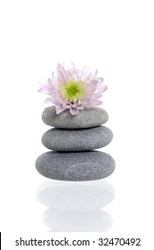 Pebbles stack with pink daisy