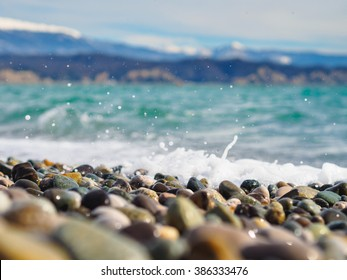 Pebbles and wave